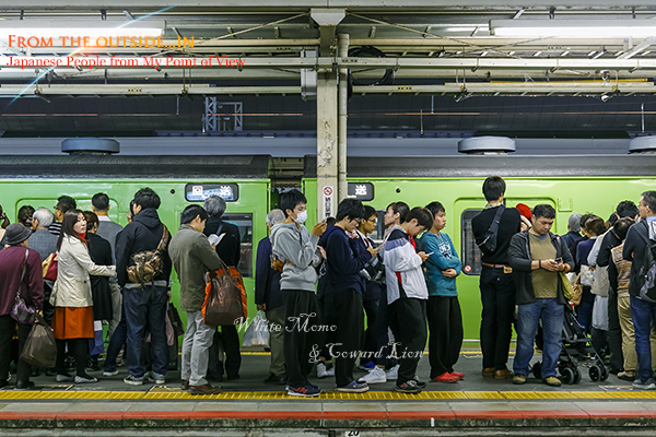 KYOTO, JAPAN - NOVEMBER 22 2015: Crowded people gathere on a platform at Kyoto Station in a peak autumnal season